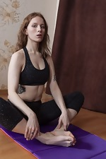 Cristy Red enjoys naked yoga on her mat